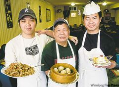 Dragon Palace owner Yuk Ho (centre, with dumplings), with nephews Jian Ang (left, with Szechuan ginger beef), and Long Chen (right, with fried bananas).