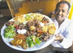 Kokeb's Robel Arefaine holds a combination platter; below, a plate of spicy samosas.