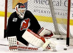Devils goalie Martin Brodeur makes a save during practice in preparation for Game 1 of the Stanley Cup final against the Los Angeles Kings tonight in New Jersey.