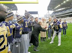 Bomber Hall of Famer Kenny Ploen shakes Mayor Sam Katz's hand as dignitaries, Bombers and former Bombers check out Investors Group Field Monday.