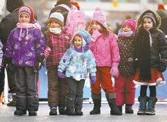Crowds of wide-eyed children gather with their families  along Portage Avenue Saturday evening during the annual Santa Claus Parade.