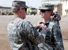 Staff Sgt. Jennifer Hunt, a civil affairs specialist in the army reserves who served in both Afghanistan and Iraq, received the Purple Heart. She and otehr servicewomen filed a lawsuit in November, challenging the Pentagon's policy excluding women from combat positions.