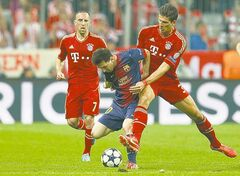 Bayern's Mario Gomez (right) fouls Barcelona's Lionel Messi during the Champions League semifinal match Tuesday.
