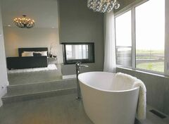 The tub off of the master bedroom overlooks the water.