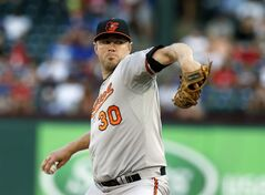 Baltimore Orioles pitcher Chris Tillman (30) throws a pitch in the first inning of a baseball game against the Texas Rangers Thursday, June 5, 2014, in Arlington, Texas. (AP Photo/Sharon Ellman)