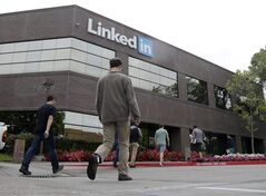 People walk outside of LinkedIn headquarters on Thursday, May 8, 2014, in Mountain View , Calif. The Oakland Tribune reports that the company is proposing adding multiple office buildings in Mountain View, its headquarters, that could total as much as 2.9 million square feet. The news comes as LinkedIn has signed a lease to occupy an entire 26-story building going up in San Francisco. (AP Photo/Marcio Jose Sanchez)