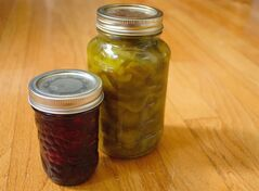 Raspberry Jam and bread and butter pickles preserves are pictured on Wednesday July 30, 2014. THE CANADIAN PRESS/Megan Cole