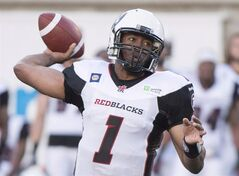 Ottawa Redblacks' quarterback Henry Burris throws a pass against the Montreal Alouettes during first half CFL action in Montreal, Friday, June 20, 2014. Burris will lead the Redblacks in their historic home opener against the Toronto Argonautson Friday. THE CANADIAN PRESS/Graham Hughes