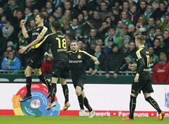 Dortmund's Robert Lewandowski of Poland, left, celebrates with teammates after scoring during the German first division Bundesliga soccer match between Werder Bremen and Borussia Dortmund in Bremen, Germany, Saturday, Feb. 8, 2014. (AP Photo/Frank Augstein)