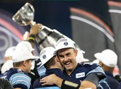 Toronto Argonauts quarterback Ricky Ray celebrates with teammates after winning CFL Grey Cup over the Calgary Stampeders Sunday.