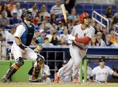 St. Louis Cardinals' Jon Jay watches after hitting a two-run home run as Miami Marlins catcher Jarrod Saltalamacchia, left, looks on in the fourth inning during a baseball game, Monday, Aug. 11, 2014, in Miami. (AP Photo/Lynne Sladky)