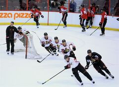 Members of the Ottawa Senators practice during the first day of training camp in Ottawa on Sunday, January 13, 2013. THE CANADIAN PRESS/Fred Chartrand