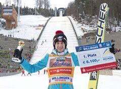 Winner Kamil Stoch of Poland celebrates during the FIS World Cup ski jumping in Willingen, Germany, Sunday, Feb. 2, 2014. (AP Photo/Jens Meyer)