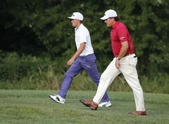Rickie Fowler, left, and Phil Mickelson walk down the fairway on the sixth hole during a practice round for the PGA Championship golf tournament at Valhalla Golf Club on Tuesday, Aug. 5, 2014, in Louisville, Ky. The tournament is set to begin on Thursday. (AP Photo/Mike Groll)