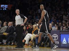 Brooklyn Nets center Jason Collins comes into the game for the first time during the first half of an NBA basketball against the Los Angeles Lakers, Sunday, Feb. 23, 2014, in Los Angeles. (AP Photo/Mark J. Terrill)