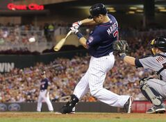 Minnesota Twins first baseman Joe Mauer hits a two-run single off Detroit Tigers pitcher Ian Krol in the sixth inning of a baseball game, Friday, Aug. 22, 2014, in Minneapolis. (AP Photo/Jim Mone)