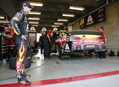 Driver Jeff Gordon waits for the start of practice for the Brickyard 400 Sprint Cup series auto race at the Indianapolis Motor Speedway in Indianapolis, Saturday, July 26, 2014. (AP Photo/R Brent Smith)