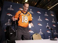 Denver Broncos quarterback Peyton Manning arrives for a news conference Wednesday, Jan. 29, 2014, in Jersey City, N.J. The Broncos are scheduled to play the Seattle Seahawks in the NFL Super Bowl XLVIII football game Sunday, Feb. 2, in East Rutherford, N.J. (AP Photo/Mark Humphrey)