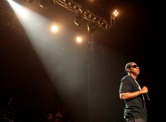 FILE - In this Nov. 11, 2007, file photo, recording artist Jay-Z performs at Hammerstein Ballroom, in New York. Jay Z will headline the Global Citizen Festival on Sept. 27, 2014, in New York's Central Park.(AP Photo/Gary He, File)