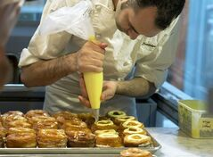 FILE - Chef Dominique Ansel makes Cronuts, a croissant-donut hybrid, at the Dominique Ansel Bakery in New York on June 3, 2013. The pastry chef introduced it in May 2013, and bakeries in London, Toronto, Seoul and elsewhere have copied it. (AP Photo/Richard Drew)