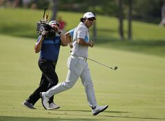 Hideki Matsuyama, right, of Japan, runs to see his shot into the 18th hole during the final round of the Memorial golf tournament on Sunday, June 1, 2014, in Dublin, Ohio. Matsuyama won the tournament in a playoff. (AP Photo/Darron Cummings)