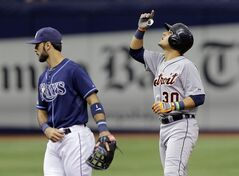 Detroit Tigers' Eugenio Suarez, right,gestures behind Tampa Bay Rays second baseman Sean Rodriguez after hitting a double off Rays pitcher Brad Boxberger during the eighth inning of a baseball game Thursday, Aug. 21, 2014, in St. Petersburg, Fla. (AP Photo/Chris O'Meara)