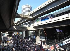 FILE - In this Jan. 13, 2014 file photo, a sky train runs above anti-government protesters gathered for a rally at Siam shopping district Monday, Jan. 13, 2014, in Bangkok, Thailand. The head of Thailand's military junta said Friday, June 13 he is considering a 3 trillion baht ($93 billion) plan to build more rail lines and other infrastructure, adding more than $30 billion to a canceled project of the government it ousted. (AP Photo/Sakchai Lalit, File)