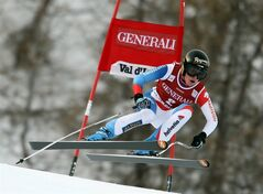 Switzerland's Lara Gut speeds down the course to place first in a women's Alpine Ski World Cup downhill race, in Val d'Isere, France, Friday, Dec.14, 2012. (AP Photo/Marco Trovati)