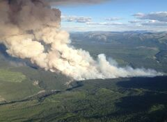 An aerial view of the Red Deer Creek wildfire near the B.C./Alberta boundary is shown in a government of British Columbia handout photo. A raging wildfire has now burned through twenty-square kilometres of northeastern B.C. brush as the Red Deer Creek blaze is fanned by strong winds. THE CANADIAN PRESS/HO