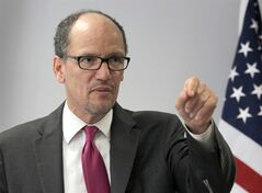 This photo taken June 4, 2014 shows Labor Secretary Thomas Perez speaking in Washington. Perez has issued a rule to raise the minimum wage for federal government workers and contractors to $10.10 an hour. The raise, from $7.70 an hour now, was proposed earlier this year by President Barack Obama. The higher level will take effect on Jan. 1, 2015. (AP Photo/Connor Radnovich)