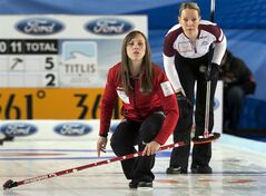 Canada's skip Rachel Homan, left, and Latvia's Dace Munca watch a rock at the world women's curling championship in Riga, Latvia on Sunday, March 17, 2013. THE CANADIAN PRESS/Andrew Vaughan