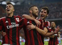 AC Milan forward Jeremy Menez, center, celebrates with teammates Stephan El Shaarawy, left, and Andrea Poli after scoring his side's third goal, during a Serie A soccer match between AC Milan and Lazio, at the San Siro stadium in Milan, Italy, Sunday, Aug. 31, 2014. (AP Photo/Luca Bruno)