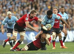 Waratahs' Tatafu Polota Nau, right, is tackled by Crusaders' Dominic Bird, left, and Richie McCaw during their Super Rugby final match in Sydney, Australia, Saturday, Aug. 2, 2014. (AP Photo/Rob Griffith)