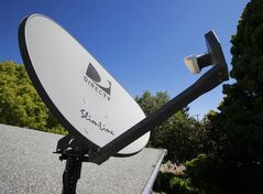 A DirecTV satellite dish is shown at a home in Palo Alto, Calif., May 6, 2010. THE CANADIAN PRESS/AP, Paul Sakuma