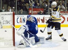 Boston Bruins left winger Brad Marchand (63) watches a goal on Toronto Maple Leafs goaltender Ben Scrivens (left) during first period NHL action in Toronto on Saturday November 5, 2011. THE CANADIAN PRESS/Frank Gunn
