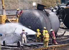 Firefighters spray foam on the train crash site in Lac-Megantic, Que., Sunday, July 14, 2013. THE CANADIAN PRESS/Jacques Boissinot