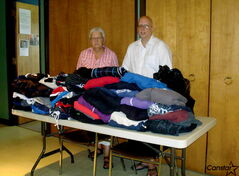 Patrick Woodbeck, associate minister at Windsor Park United Church, and church member Margo Baldwin with donated clothing destined for Rossbrook House, an alternative school and drop-in centre for kids and youth in the inner city.