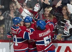 Montreal Canadiens' Max Pacioretty, centre, celebrates his goall against the Boston Bruins with teammates Brendan Gallagher, left, and David Desharnais during second period NHL playoff hockey action on Monday, May 12, 2014 in Montreal. THE CANADIAN PRESS/Paul Chiasson