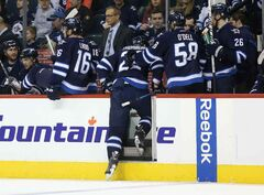 Winnipeg Jets' Chris Thorburn leaves the game during the second period after getting hurt, Friday, March 14, 2014. Today, the Jets announced Thorburn has a broken bone and is out indefinitely.