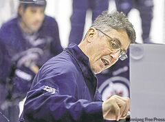Winnipeg Jets' coach Claude Noel explains a drill during practice at MTS Centre, Sunday.