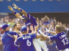 Blue Jays left-fielder Rajai Davis (centre) and teammates celebrate like they've won the World Series.