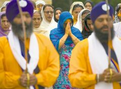 A prayer service is held outside the Sikh Temple of Wisconsin in Oak Creek, Wis.