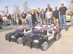 More than 30 members from the MBLX car club collectively raised more than $900 and donated three battery-operated children's cars to the Rehab Centre.
