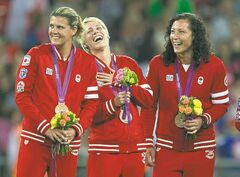 Christine Sinclair (left to right), Sophie Schmidt and Melissa Tancredi smile as the team receives the bronze medal for soccer at the 2012 London Olympics.