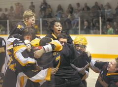 Team Manitoba celebrates after defeating Team Saskatchewan 6-4 in the gold medal B game at the Bantam Box Lacrosse National Championship at the Billy Mosienko Arena. At left, Team Manitoba player Cam Smellie is chased by Saskatchewan�s Adam Williams.