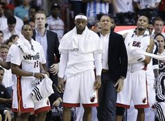 Miami Heat forward LeBron James (6), center, Miami Heat guard Mario Chalmers (15), left, forward Rashard Lewis (9), right and Michael Beasley, second from right look down the court during the second half in Game 3 of the NBA basketball finals against the San Antonio Spurs, Tuesday, June 10, 2014, in Miami. (AP Photo/Wilfredo Lee)
