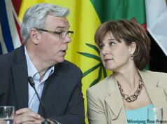 Premier Greg Selinger and B.C. Premier Christy Clark, shown at a premiers conference in Yellowknife in June, have bet on the outcome of the Grey Cup game on Sunday.