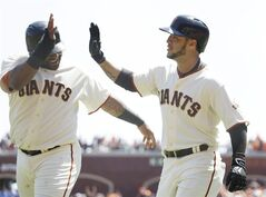 San Francisco Giants' Gregor Blanco, right, is greeted by teammate Pablo Sandoval, left, after hitting a two-run home run off Colorado Rockies starting pitcher Jordan Lyles in the second inning of their baseball game Thursday, Aug. 28, 2014, in San Francisco. (AP Photo/Eric Risberg)