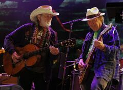 FILE - In this Sept. 22, 2012 file photo Neil Young, right, and Willie Nelson perform during the Farm Aid 2012 concert at Hersheypark Stadium in Hershey, Pa. Opponents of a proposed pipeline that would carry oil from Canada south to the Gulf Coast said Monday, Aug. 18, 2014 that Nelson and Young will headline a concert on Sept. 27 on a farm near Neligh in northeast Nebraska. (AP Photo/Jacqueline Larma, File)