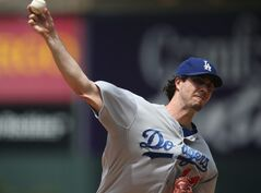 Los Angeles Dodgers starting pitcher Dan Haren works against the Colorado Rockies in the first inning of a baseball game in Denver, Saturday, July 5, 2014. (AP Photo/David Zalubowski)